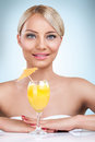 Young beautiful blonde woman drinking cocktail in a summertime Royalty Free Stock Photo