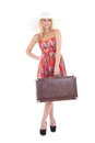Young beautiful blondie woman in red dress with brown retro suit suitcase isolated on white background Royalty Free Stock Image