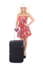 Young beautiful blondie woman in red dress with suitcase passpo passport and ticket isolated on white background Royalty Free Stock Photos