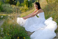 Young beautiful bride on green lawn Royalty Free Stock Photos