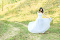 Young beautiful bride on green lawn passage Stock Image