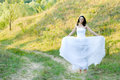 Young beautiful bride on green lawn passage Stock Photos