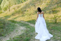 Young beautiful bride on green lawn passage Stock Images