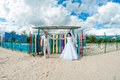 Young and beautiful bride and groom on the beach in summer Stock Photo