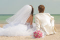 Young and beautiful bride and groom on the beach Royalty Free Stock Photo