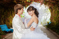 Young and beautiful bride and groom on the bench Stock Photo