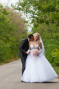 Young and beautiful bride and groom kissing Royalty Free Stock Photography