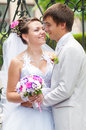 Young and beautiful bride and groom smiling at eac each othe Royalty Free Stock Photography