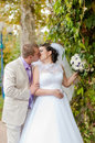 Young and beautiful bride and groom smilling Stock Photo