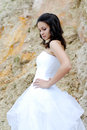 Young beautiful bride among rocks outdoors Royalty Free Stock Image