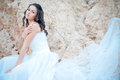 Young beautiful bride among sands Royalty Free Stock Image