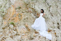 Young beautiful bride among sands thoughtful Stock Photography