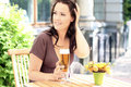 Young beautiful brunette with a beer glass Royalty Free Stock Image