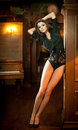 Young beautiful brunette woman in black tight fit body posing sensual in vintage scenery. Romantic mysterious young lady