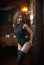 Young beautiful brunette woman in black tight fit corset posing sensual in vintage scenery. Romantic mysterious young lady Royalty Free Stock Photo