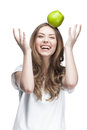 Young beautiful brunette woman with green apple this image has attached release Royalty Free Stock Images