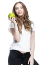 Young beautiful brunette woman holding green apple this image has attached release Stock Photos