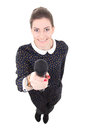 Young beautiful business woman in black dress with microphone is Stock Images