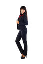Young beautiful business woman caucasian in black jacket isolated in full length on white background looking at the camera Stock Photos