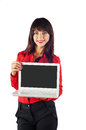 Young beautiful business woman caucasian in red t shirt showing white laptop isolated on white background looking at the camera Royalty Free Stock Photography