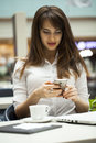 Young beautiful business woman reading messages Royalty Free Stock Photo