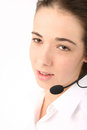 Young beautiful business woman using head phone portrait of a Royalty Free Stock Image