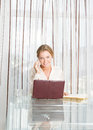 Young beautiful business woman working with laptop i portrait of in office Royalty Free Stock Photo