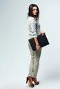 Young beautiful businesswoman holding laptop Stock Photo