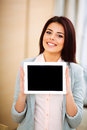 Young beautiful businesswoman showing ipad where you can put your image or text Stock Photos
