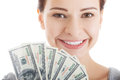 Young beautiful casual woman holding large sum of money. Royalty Free Stock Photo