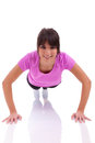 Young beautiful caucasian fitness woman doing push up exercises Royalty Free Stock Image