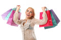 Young beautiful caucasian woman holds colorful shopping bags and Royalty Free Stock Photo