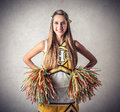 Young beautiful cheer leader student beeing a Stock Images
