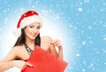 Young and beautiful Christmas shopper girl Royalty Free Stock Photo
