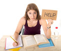 Young beautiful college student girl studying for university exam in stress asking for help under test pressure and sitting on Stock Photo