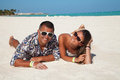 Young beautiful couple enjoying the sunset in luxury resort fashion relax on a tropical beach at cap cana dominican republic Stock Image