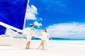 Young beautiful couple having fun on a tropical beach . Tropache Royalty Free Stock Photo