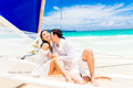 Young beautiful couple having fun on a tropical beach . Tropical Royalty Free Stock Photo