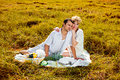 Young beautiful couple having picnic making in the park Stock Photo
