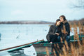 Young beautiful couple on the ice of a frozen lake Royalty Free Stock Photo