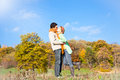 Young beautiful couple are kissing in the autumn park Royalty Free Stock Image
