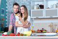 Young and beautiful couple in love is cooking food on the kitchen Royalty Free Stock Photo