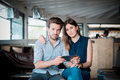 Young beautiful couple lovers at the cafe using tablet Royalty Free Stock Images