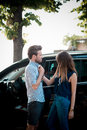 Young beautiful couple lovers in the car Stock Photos