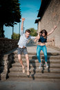 Young beautiful couple lovers outdoors jumping Royalty Free Stock Photo
