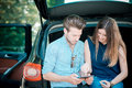 Young beautiful couple lovers using tablet in the car travel Royalty Free Stock Photo