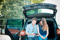 Young beautiful couple lovers using tablet in the car travel Royalty Free Stock Photos