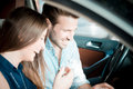 Young beautiful couple lovers using tablet in the car travel Stock Photo