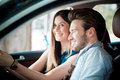Young beautiful couple lovers using tablet in the car travel Stock Photography