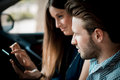 Young beautiful couple lovers using tablet in the car travel Stock Photos